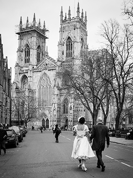 Bride and groom walk towards York Minster www.oliviabrabbs.co.uk