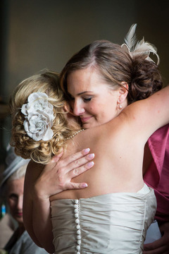 bridesmaid hugs bride at wedding www.oliviabrabbs.co.uk