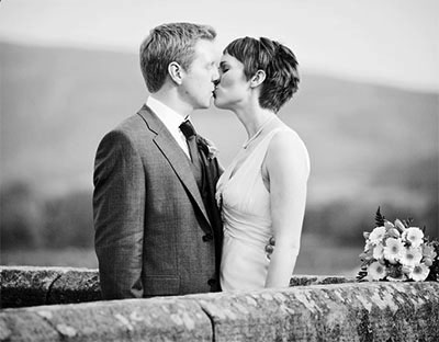 documentary wedding photography of couple on the bridge at burnsall