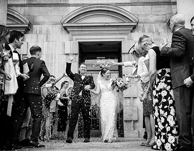 leeds wedding photography bride and groom leaving civic hall with confetti